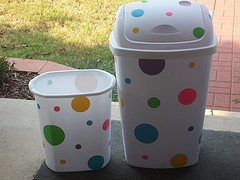 turn plain trash cans into these with sheets of duct tape, use die cut machine to cut circles or whatever pattern you wish and wa-lah!--AWESOME IDEA THAT I NEED TO DO!!!!