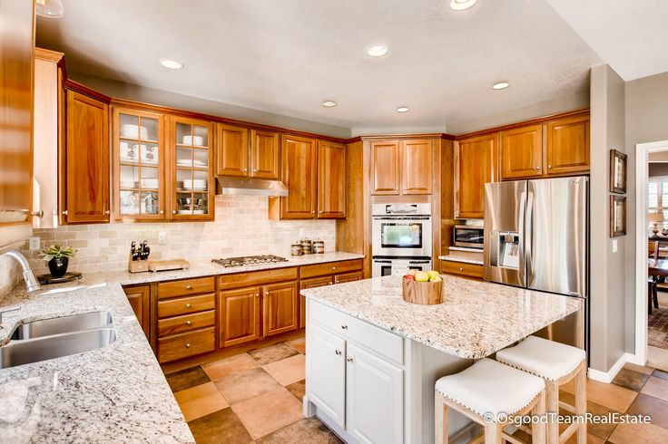 Chefs Kitchen! Beautiful granite, cherry cabinets, Bosch dishwasher and 5 burner cooktop with Zephyr vent hood. Center island with seating makes for fun Saturday mornings.