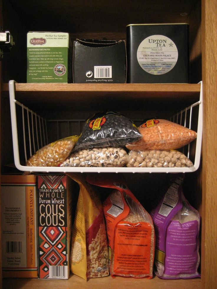 A tip from professional organizer Tidy Tova: Max out your vertical storage by adding undershelf baskets. They instantly multiply your cabinet's capacity and create designated areas for different types of ingredients.
