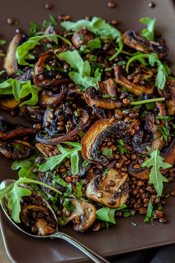 ½ cup French lentils 2 cups water 1 tbs olive oil 300g mix of button and portobello mushrooms, sliced 2 cloves of garlic, finely chopped ¼ tsp chilli flakes, or more to taste 1 tbs lemon juice 1 tbs good quality extra virgin olive oil sea salt and pepper, to taste 2 tbsp flat leaf parsley, roughly chopped ½ cup rocket (arugula)