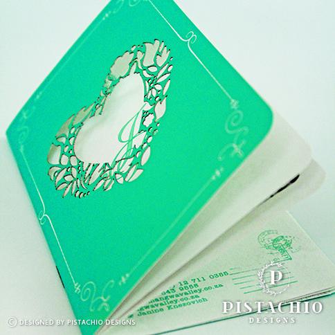 Beautiful heart laser passport wedding invitation made by www.pistachiodesigns.co.za