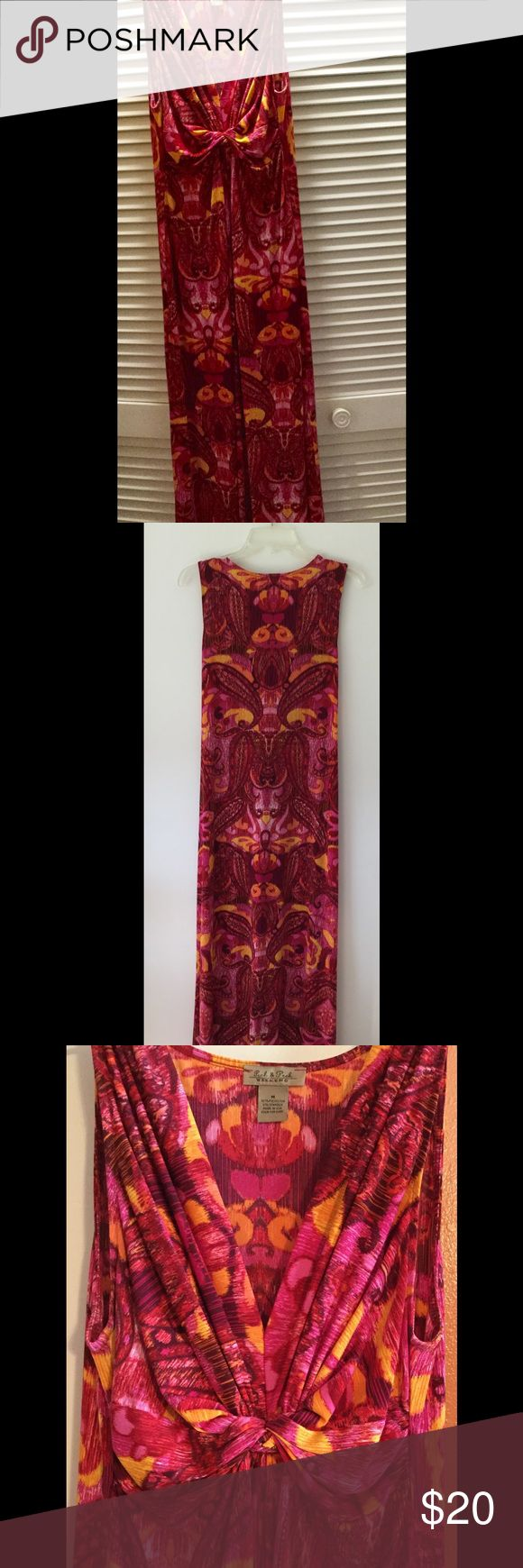 "Pink & yellow maxi dress. Size medium. V-neck. Peck and Peck Weekend beautiful medium size pink/yellow/red multi colored maxi dress. 95% polyester, 5% spandex. V-neck with knot design in front. Hangs loose. Machine wash and tumble dry. Had altered to fit my 5'5"" height. Like new. Only wore 3/4 occasions. Very classy look when paired with sandals for a casual look or heels for a dressy look. Peck & Peck Weekend Dresses Maxi"