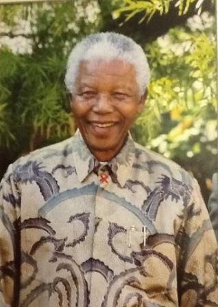 "Nelson Mandela photo hanging in the SABC Radio Archives - priceless treasure from the launch of his CD ""The voice of Nelson Mandela"" in 1999  http://sabcmedialib.blogspot.com/2013/07/nelson-mandelas-voice-priceless.html"