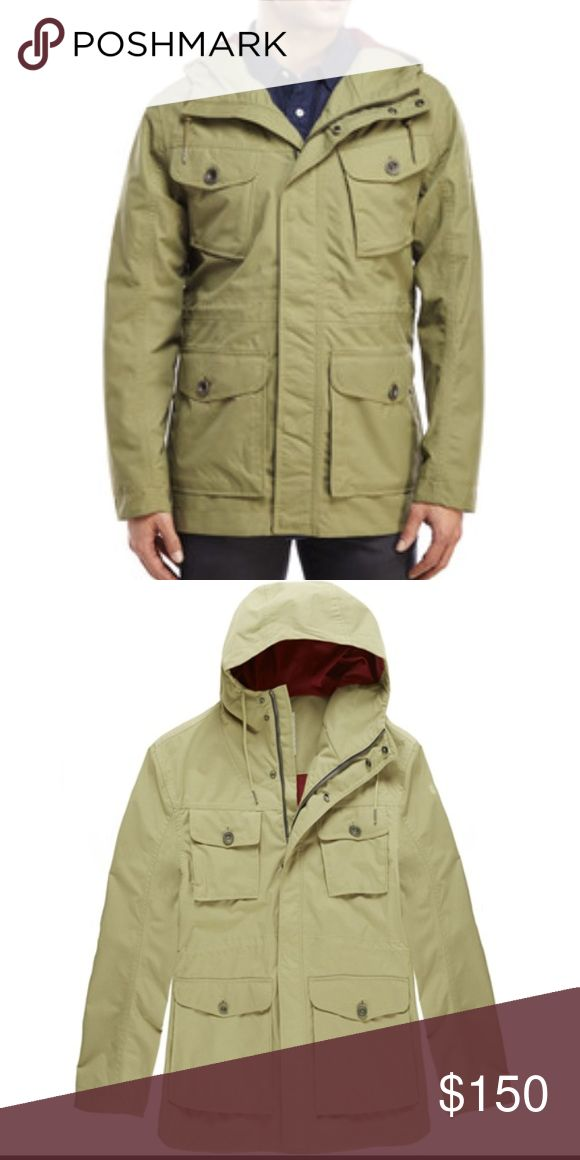 Timberland   Mount Shaw Canvas Jacket A rugged canvas construction combined with HyVent® waterproof technology and sealed seams ensures that you stay dry in this durable, all-season jacket. Four pockets and an interior drawstring customizes the fit while trapping the heat. Front covered snap and zip closure. Front button-flap pockets; chest button-flap pockets; interior pocket. Adjustable hood. Fully lined. 100% Cordura Timberland Jackets & Coats