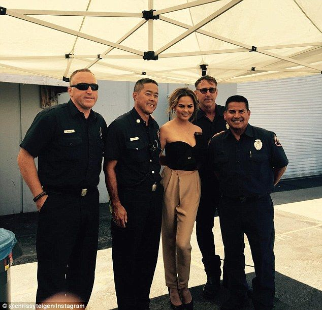 Firemen: Chrissie Teigen captioned the first of the shots on Saturday: Fire house next to ...