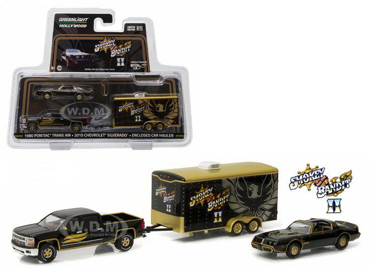 "diecastmodelswholesale - 2015 Chevrolet Silverado and 1980 Pontiac Trans Am with Enclosed Car Hauler ""Smokey"