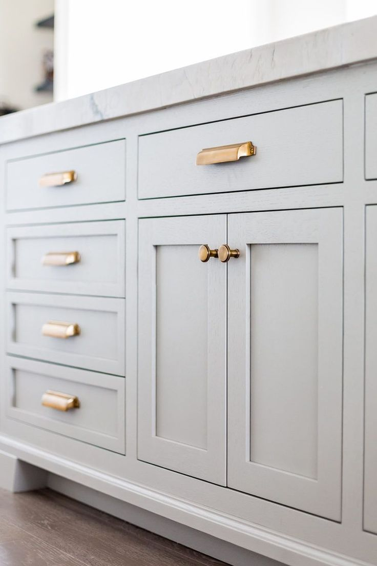 Kitchen Details: gray painted cabinets, Paint, brass hardware, floor