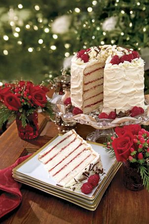 White chocolate raspberry cake with white chocolate frosting. Looks and sounds *amazing* even though I don't eat alot of sweets......I am glad to see layered cakes coming back!