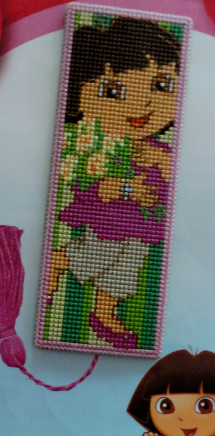 Bookmark Dora embroidered on plastic canvas.