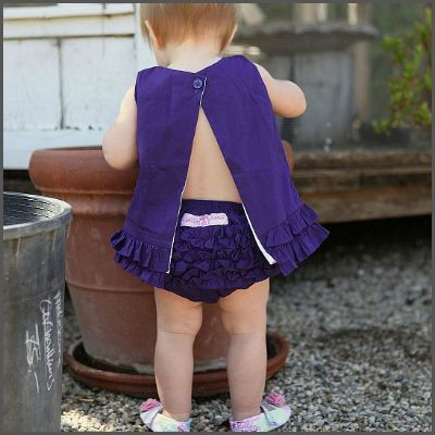 RuffleButt Bloomer - Grape. With it's fun and frilly style, this ruffled bloomer adds a touch of innocence to any outfit. With 100% cotton body and exclusive anti-wrinkle ruffles, this sweet grape bloomer is nothing but the best for your baby girl!
