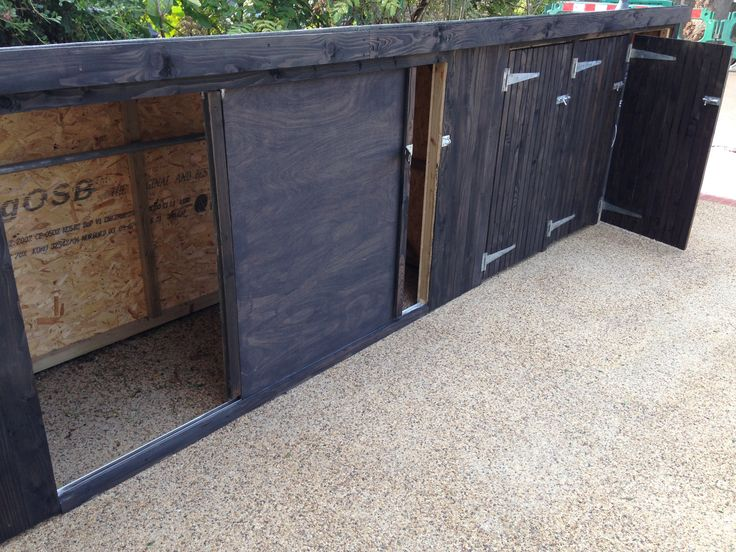 Black stained Classic with 3 wheely bin stores added to the right