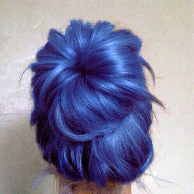 Gorgeously Thick Lapis-Blue Hair Styled in a Messy Bun