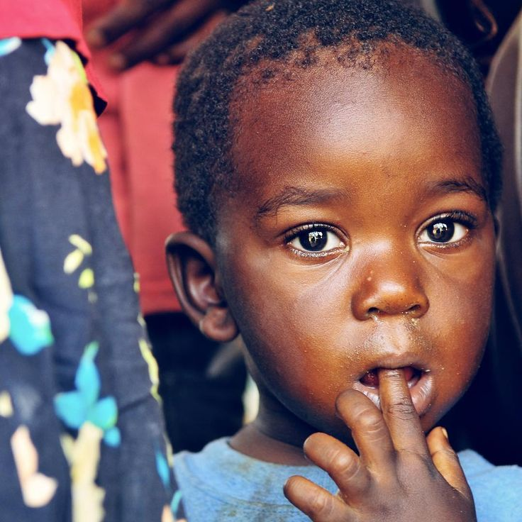 One of my favorite photos a young boy in a village somewhere in #Bopolu #district of Western #Liberia a country I have a great passion for. This area was hit hard by the #Ebola crisis shortly after my visit. I took this photo as we met with the local community members who welcomed us discussed sustainability and provided some soccer balls for the kids for the first time! #IDEAS @ideasforus.ngo #sustainability #village #Africa #sustainabledevelopment #beautiful