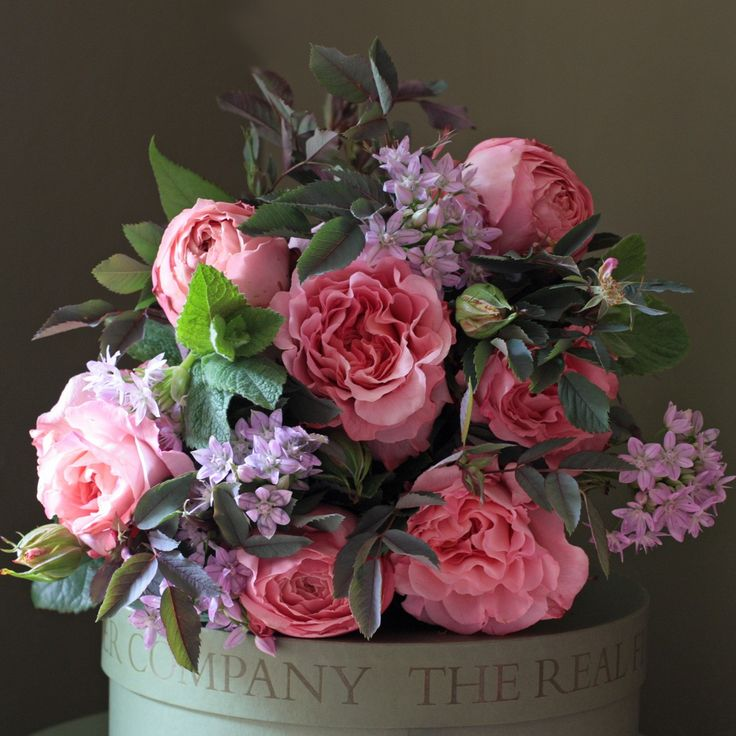 This delightful posy is filled with English grown dusky pink scented garden roses with English grown apple mint and foliage.