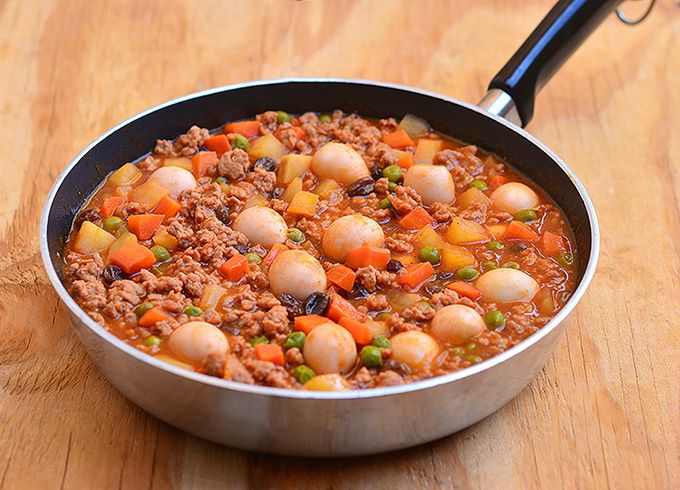 Pork Giniling with Quail Eggs is a thick and hearty stew made with ground pork, quail eggs, potatoes, carrots, bell peppers, sweet peas and raisins