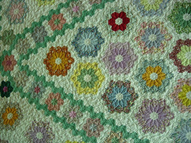 57 best grandmother 39 s flower garden quilts images on pinterest for Grandmother flower garden quilt pattern variations