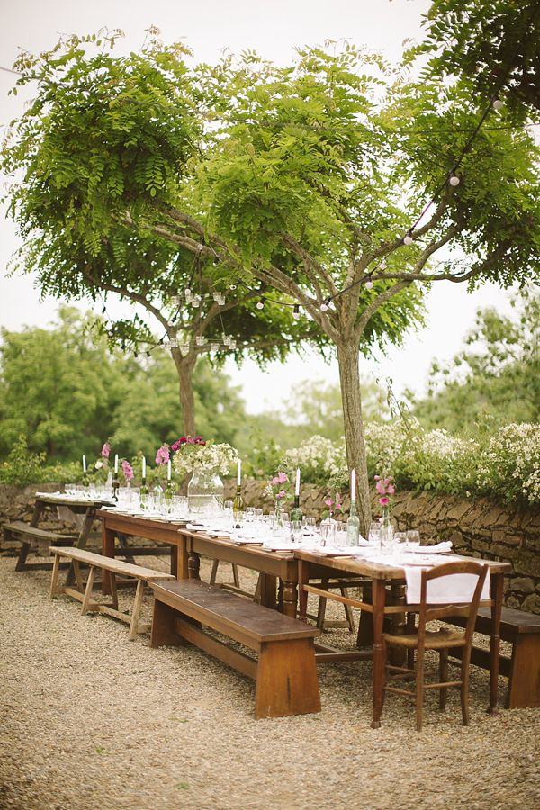 Beautiful outdoor, rustic, communal wedding table setting using long benches, from 'Wild Flowers In Her Hair ~ A Relaxed, Rustic and Intimate Wedding in the South of France', on www.lovemydress.net. Photography by http://tomravenshear.com/ Weddings in France, rural weddings, rustic weddings, outdoor weddings, natural weddings, relaxed weddings, intimate weddings