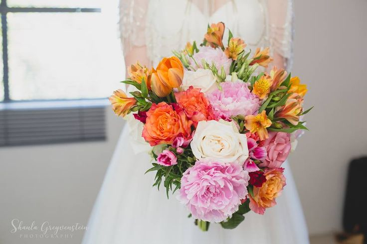 Such a spectacular bridal bouquet by Must Love Flowers includes peonies, alstroemerias, tulips, O'Hara and garden roses