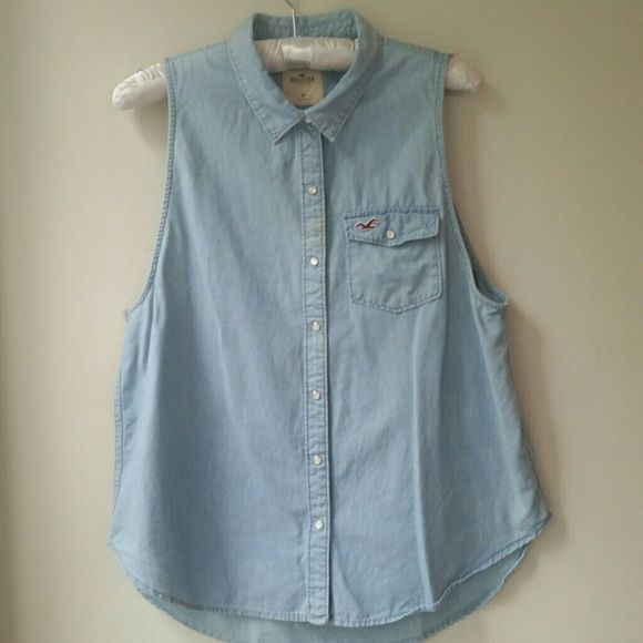 Sleeveless denim shirt Hollister Preppy summer shirt. Slight discoloration near buttons but shirt came that way so I think it's intentional. Never worn. When tried on it looked super cute tied at the bottom Hollister Tops Button Down Shirts