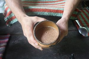 child holding fresh cocoa on the chocolate tour