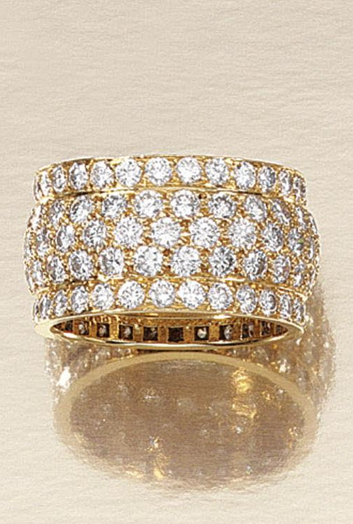 A DIAMOND RING, CARTIER  pavé-set with brilliant-cut diamonds, signed Cartier, numbered, French assay marks.