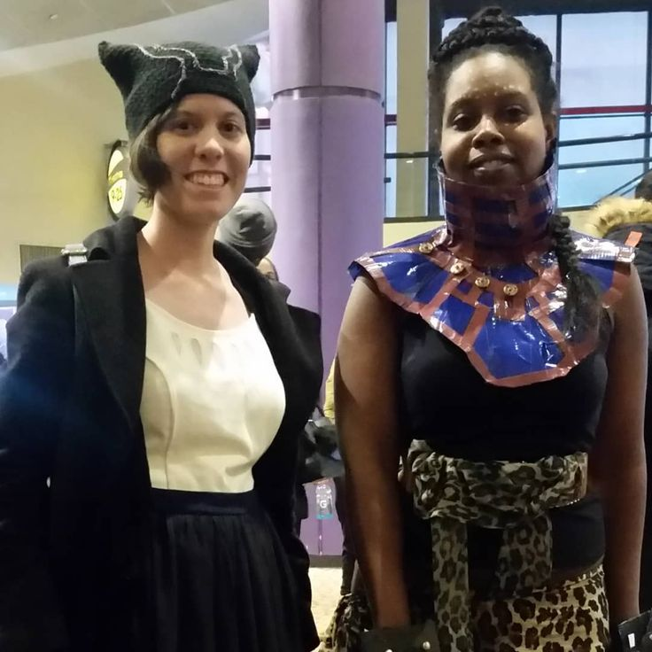 Princess Shuri and Friend of Wakanda on #wakandawednesday. IRL my crochet buddy @alexiscrafting with a beautiful crochet Black Pather hat she made. Shuri necklace made with Duck Tape by me - @scifielle  #princessshuri #shuricosplay #shuri #cosplaygirl #marvelblackpanther #crochetersofinstagram #diycosplay #disneyprincess #wakandaforever #wakandawednesdays #blackpanthercosplay