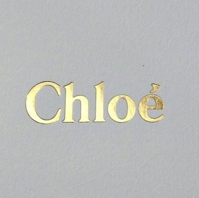chloe logo. gold foil on gray.