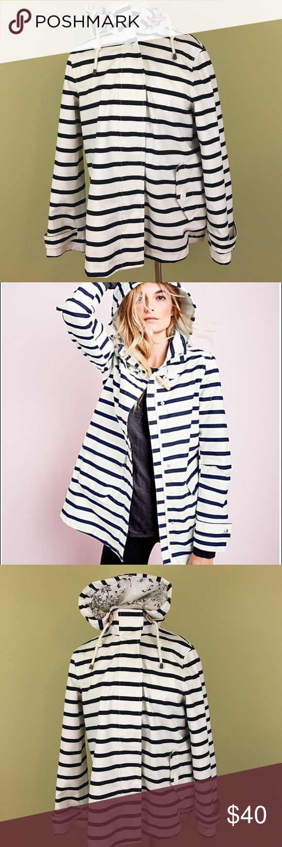 Joules Haven Waterproof Striped Jacket Sz. 10 $198 Everyone needs a fab raincoat. This Joules coat has an oversized hood, a nautical wooden toggle — and a charming paisley jersey-knit lined interior. Crafted in breathable, waterproof cotton.  FEATURES: Classic fit Stand collar Attached hood; drawcord Long sleeves Front storm flap; snap and hidden-zipper closure Two patch pockets 3/4 length 100% cotton; waterproof PU coating Cotton jersey-knit lining Imported(UK Brand) Joules Jackets & Coats…