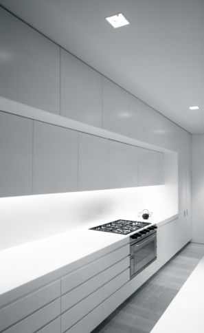 Wall kitchen solution without the window. Ian Moore Architects   Fink House