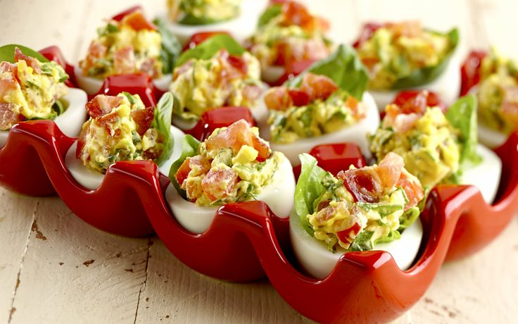 a BLT - Bacon Lettuce and Tomato Deviled Eggs. It can't get any better! They are super low carb and bariatric friendly. Make them for a party platter today.