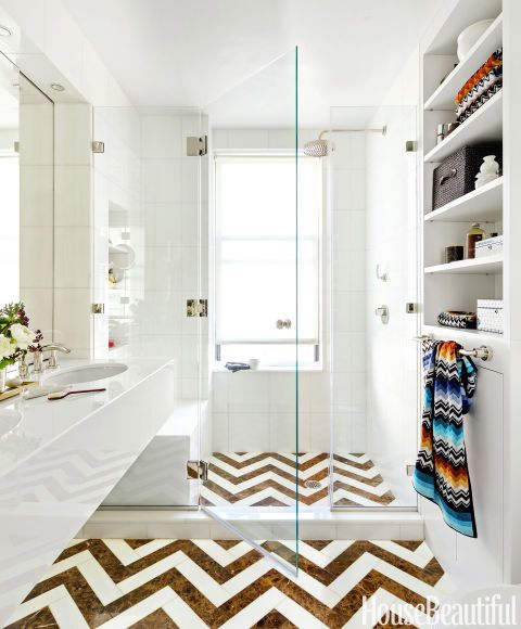 CHEVRON FLOOR – In a New York City bathroom designed by Alla Akimova, the drama is really on the floor. Glassos tiles in Vetro Bianco on the walls and the vanity reflect light beautifully. Click through to view the entire gallery and for more bathroom tile ideas.