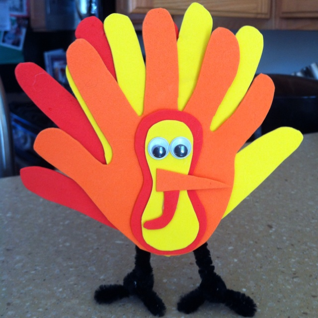 Thanksgiving craft from handprints. would be cute to do one hand for each family member and see the different sizes :)