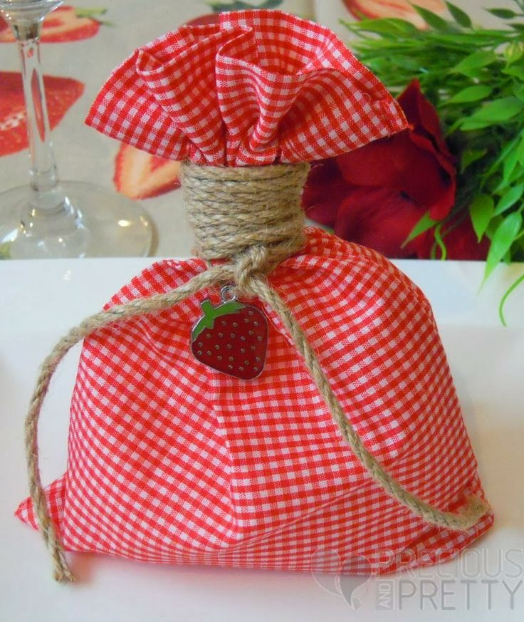Red plaid favor bags for girl's christening with a beautiful strawberry embellishment!