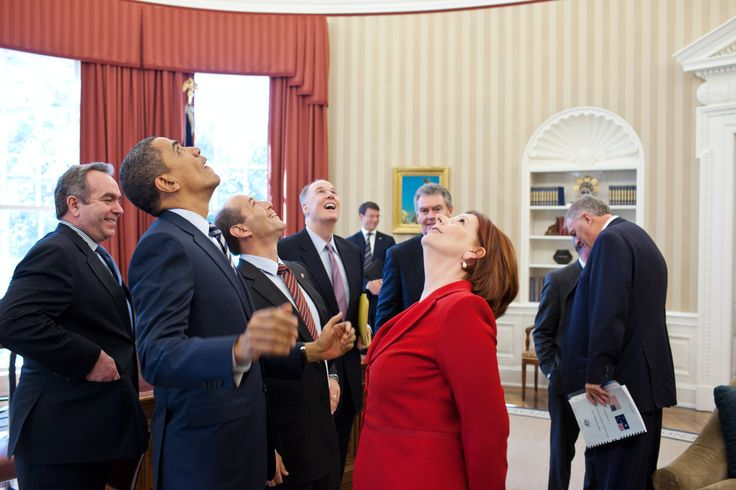 President Barack Obama, Prime Minister Julia Gillard of Australia, and members of the Australian and American delegations look up at the presidential seal in the Oval Office ceiling following their b