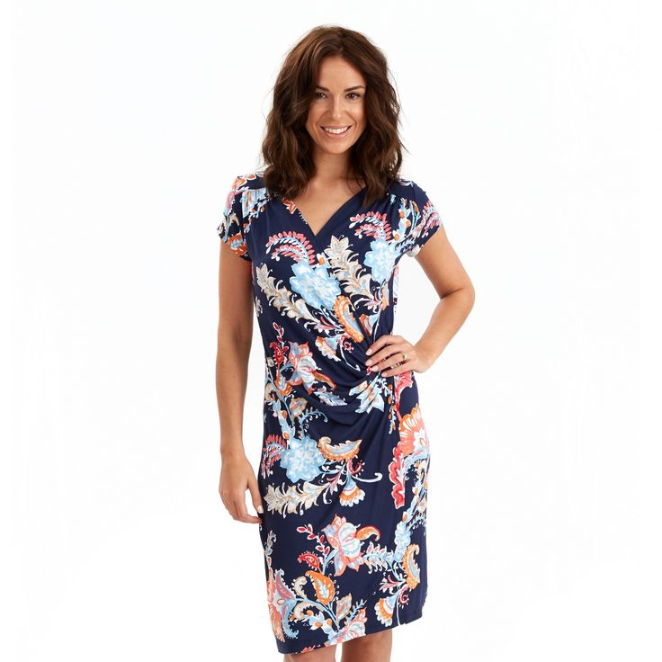 Flattering and just a little flirty, this gorgeous wrapover dress gathers at the waist and shoulder giving it a glamorous finish. The beautiful print was inspired by the Heliconia flower.  Approx Length: 97cm