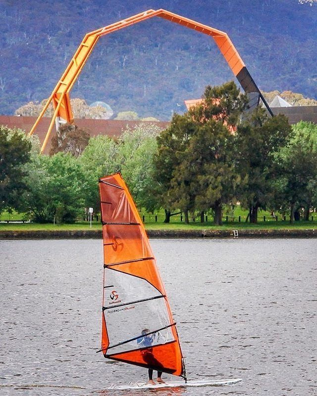 The sculptural arch of the National Museum of Australia provided a colour-coordinated backdrop for Instagrammer @cecil1958's action shot of a windsurfer out and about on Lake Burley Griffin. How will you make the most of Canberra's great outdoor offerings this weekend? #visitcanberra #onegoodthingafteranother