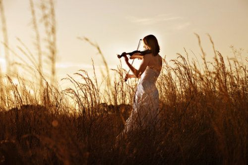 I think I would want to learn how to play the violin just so I could go play it in a field wearing a dress...