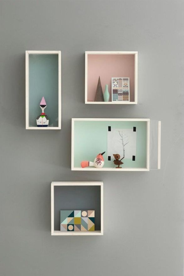 love how these shelves are outlined in white but painted various background colors...would be cute with the little house shelf idea