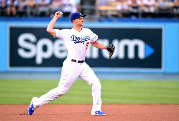 Corey Seager Photos Photos - Corey Seager #5 of the Los Angeles Dodgers makes a throw to first for an out of Ketel Marte #4 of the Arizona Diamondbacks during the first inning at Dodger Stadium on July 5, 2017 in Los Angeles, California. - Arizona Diamondbacks v Los Angeles Dodgers