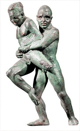 """A wrestler lifts his opponent off the ground, holding him firmly in his grasp, in this 6-inch-tall, second-century B.C.E. bronze statuette discovered in Alexandria, Egypt. The philosopher Plato (427-347 B.C.E.) encouraged Athens's youth to wrestle, and the historian Plutarch (c. 46-120 C.E.), in his Quaestiones conviviales, calls wrestling """"the most technical and the trickiest"""" of sports. A Greek wrestling manual, dating to the first or second century C.E.,"""