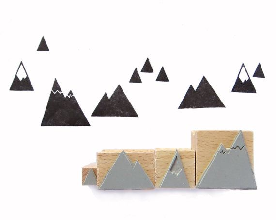 A set of stamps consisting of 4 little mountains (1-3cms) for embelleshing wrapping paper and more! Visit me on: www.nuukk.com
