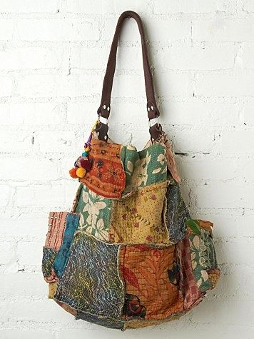 This looks as if it is made from upholstery fabric. What a great bag.