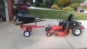 Powered Wheelbarrow - Homemade powered wheelbarrow constructed from a riding mower, cart and wheelbarrow.