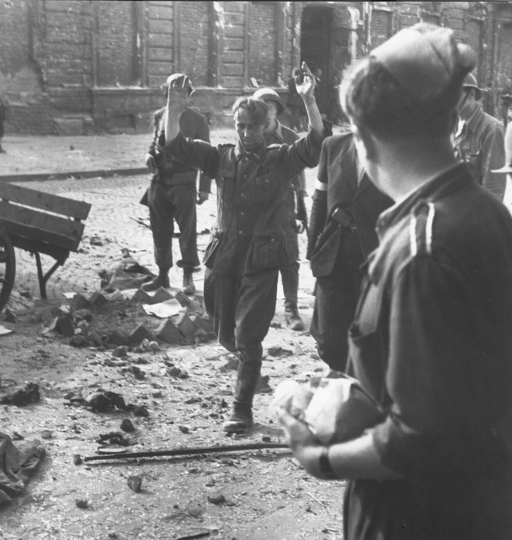 German surrenders to Polish fighters during the fighting around the building of the Warsaw telephone company, 1944.