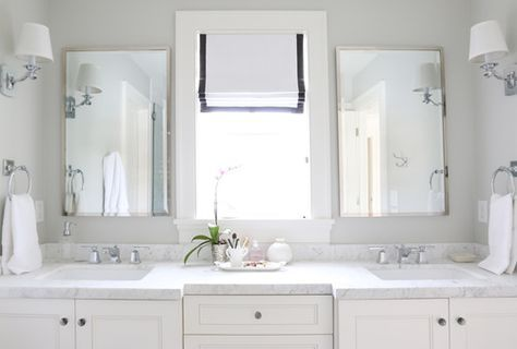Window in the middle of the double vanity.