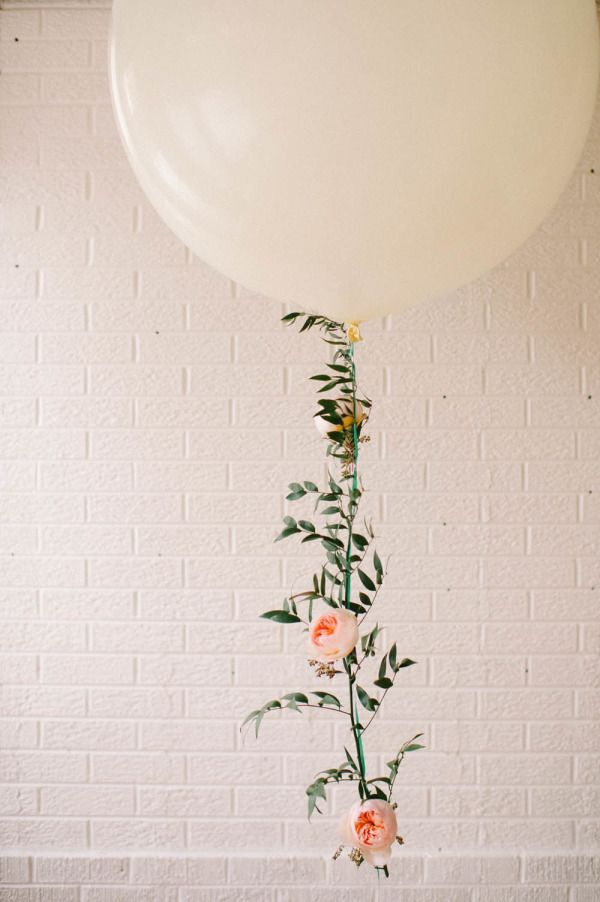 Love the idea of adding fresh florals to party balloons for an extra-special, secret garden-inspired touch.