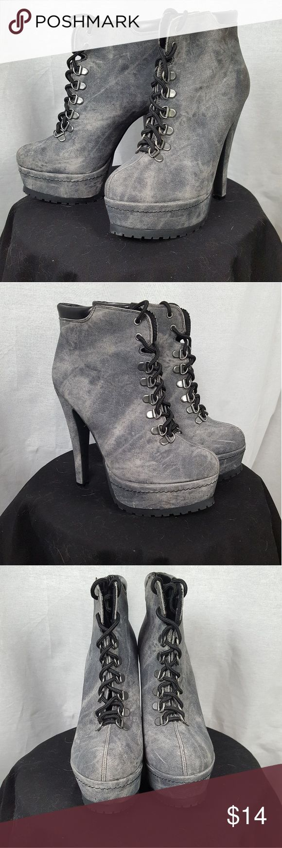 Xhilaration Grey High Heeled Boots These boots have a 4 1/2 inch heel and a slight glitter to them. They've been worn once, I bought them years ago when I thought I'd be wearing heels a lot more than I actually do.  The price is negotiable, feel free to make an offer to ask any questions! Xhilaration Shoes Heeled Boots