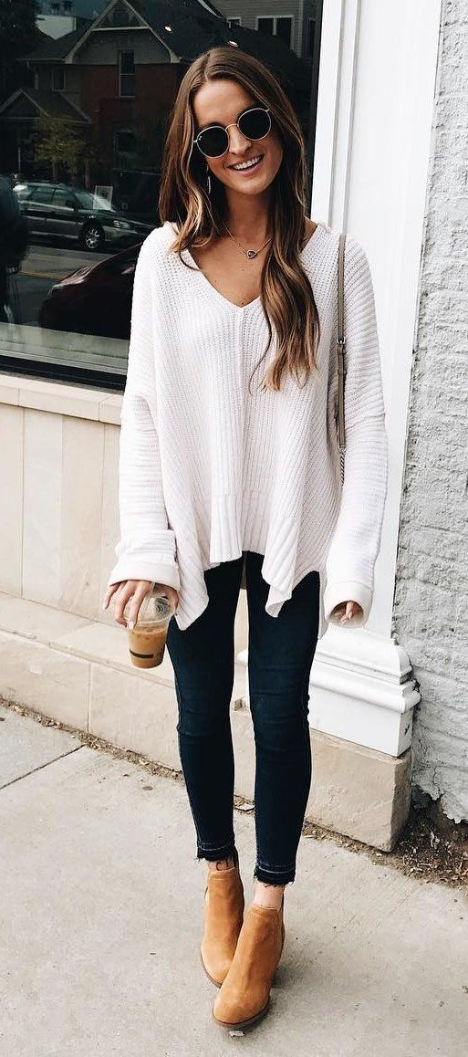 #fall #outfits women's white knitted sweater and blue jeans