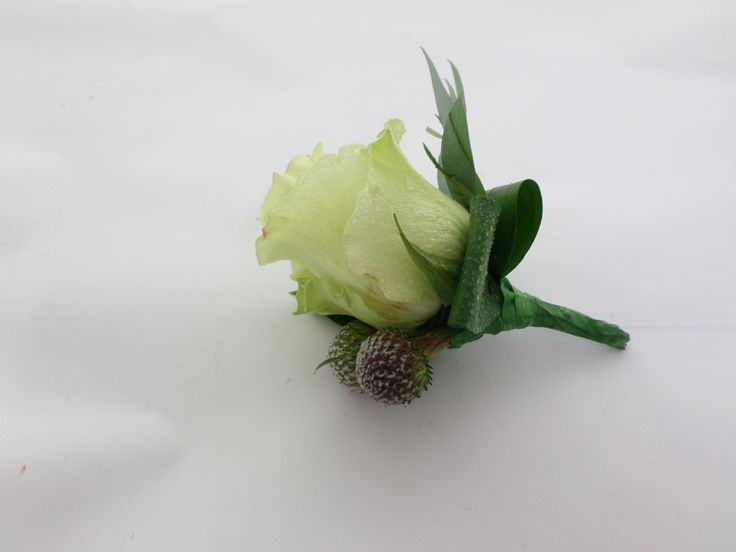 Wedding buttonhole with a white rose. Created by http://floristilene.co.nz/