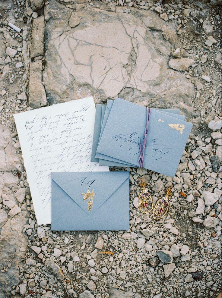 blue and white wedding invitations - photo by Zhenya Savina http://ruffledblog.com/russian-swan-princess-bridal-inspiration